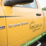 A work truck for Royal Lawn Care with a grassy design