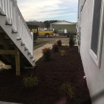 Exterior of newly built house with mulch