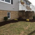 Exterior of house with mulch and shrubs